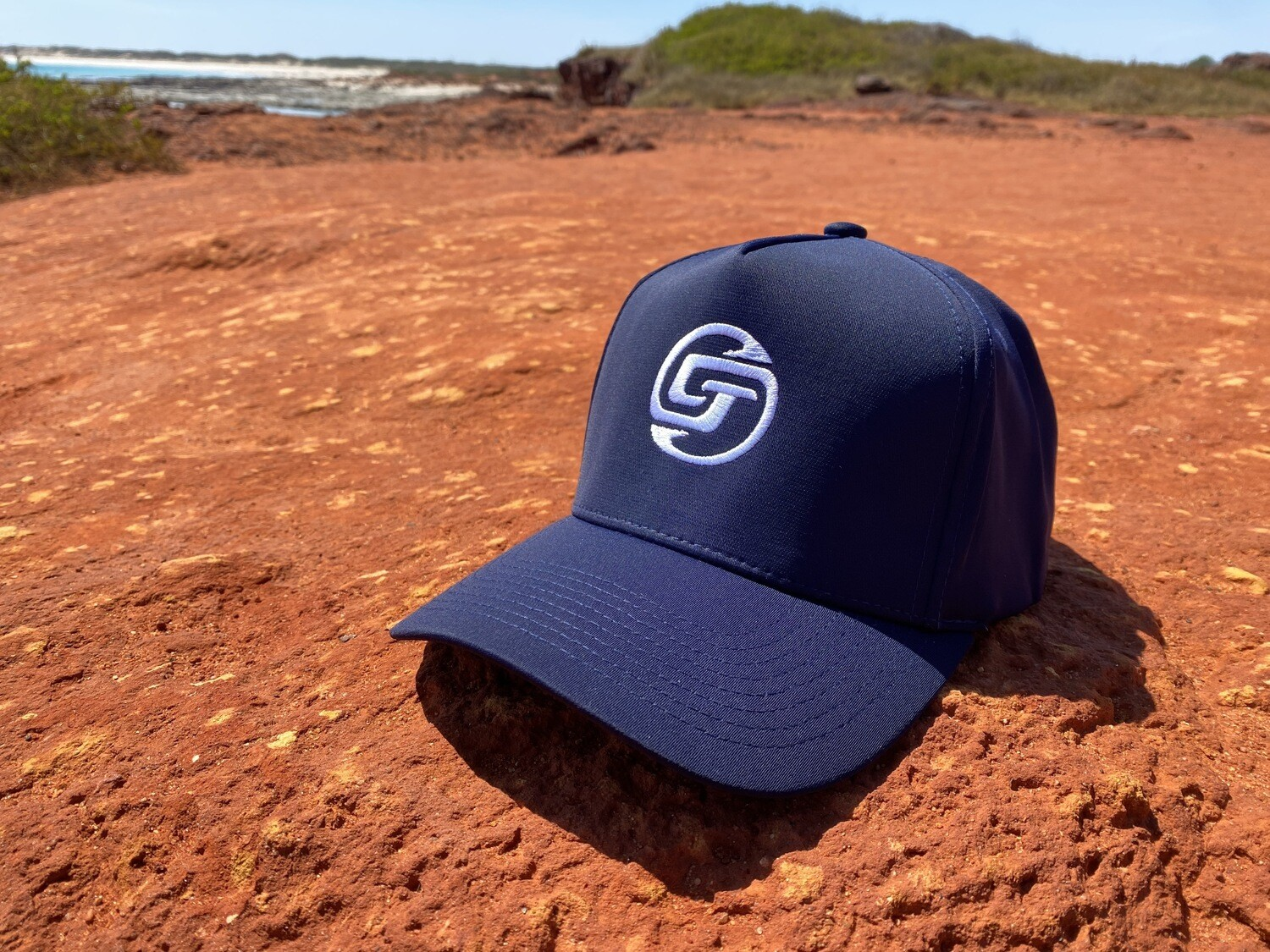 CHASIN TAIL SIGNATURE LOGO D-LUX 5 Panel Trucker Hat. Navy Blue