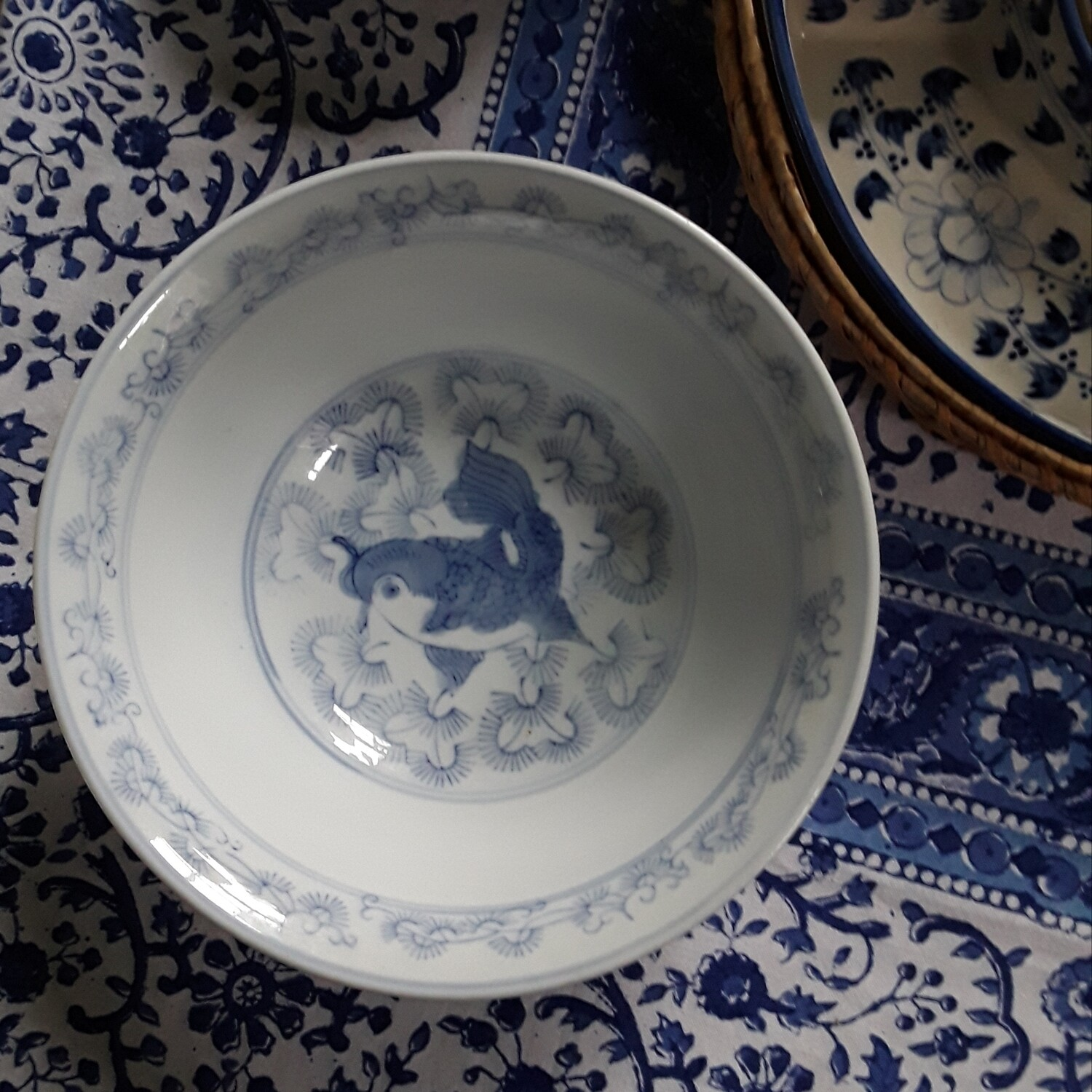 Vintage Blue and White Chinese Porcelain Bowl with Fish Motif