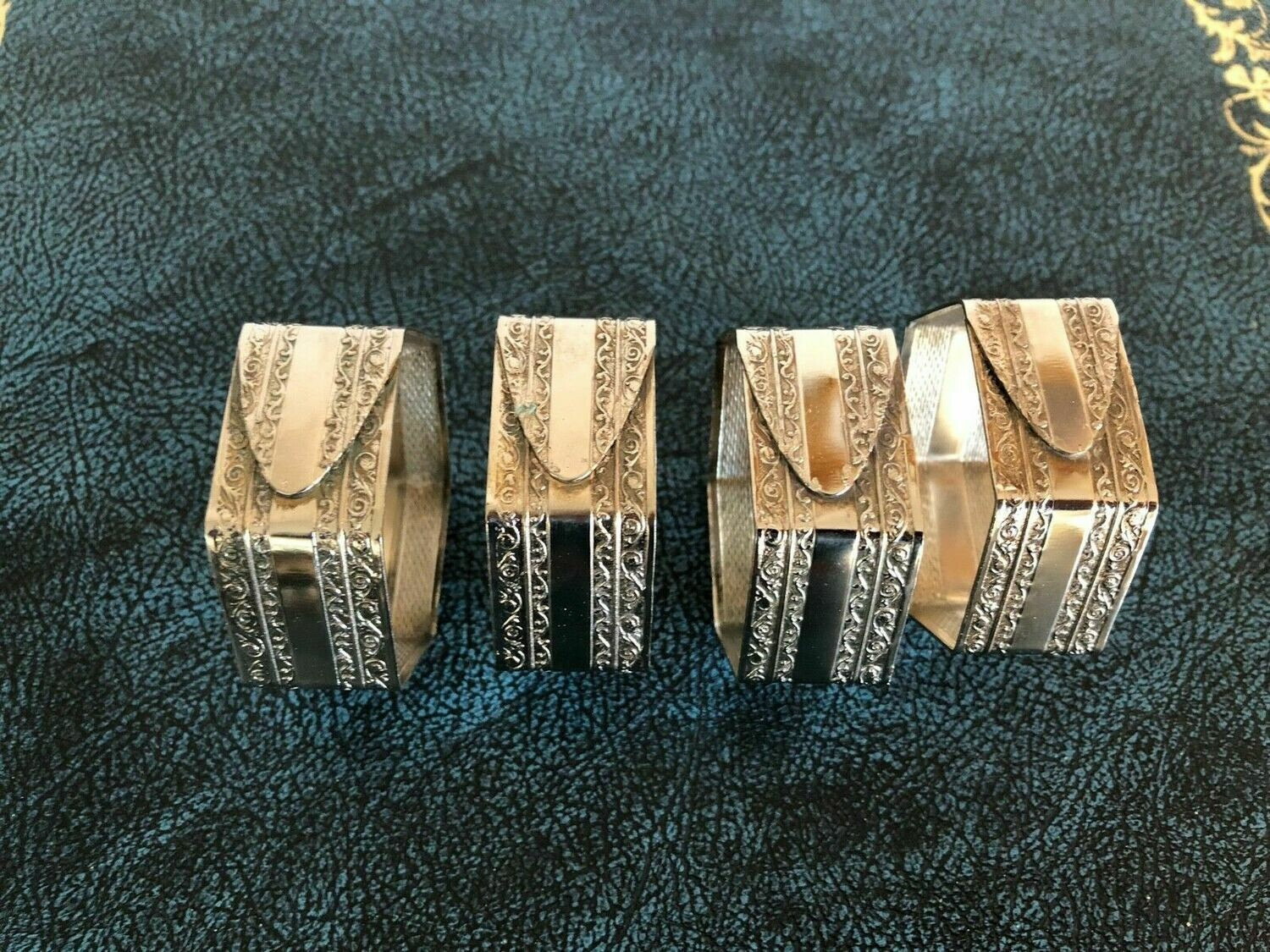 White Metal Napkin Rings - Unusual design, not silver. Set of 4