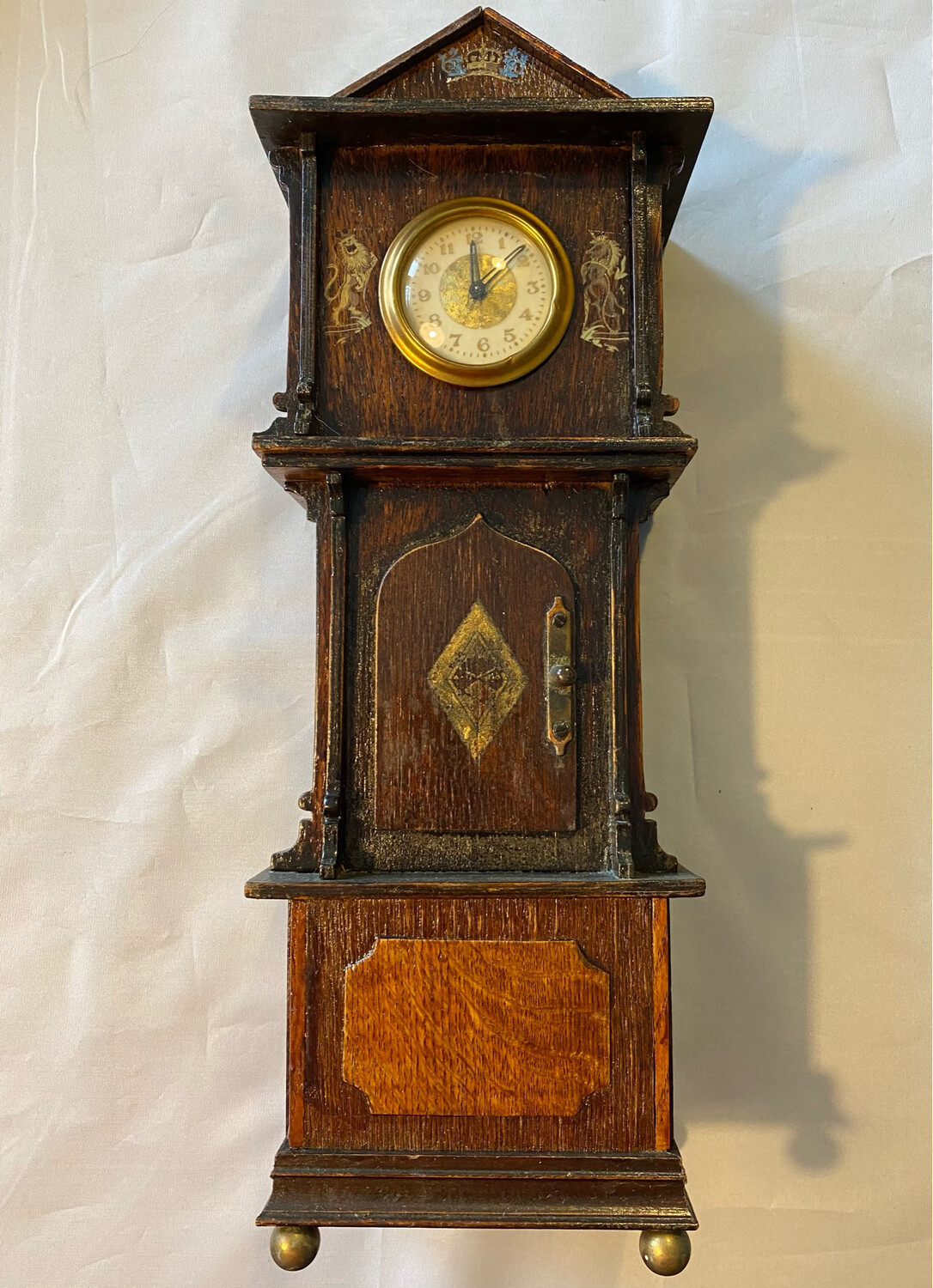 Mantle clock in Grandfather style with Royal Emblems - late Victorian