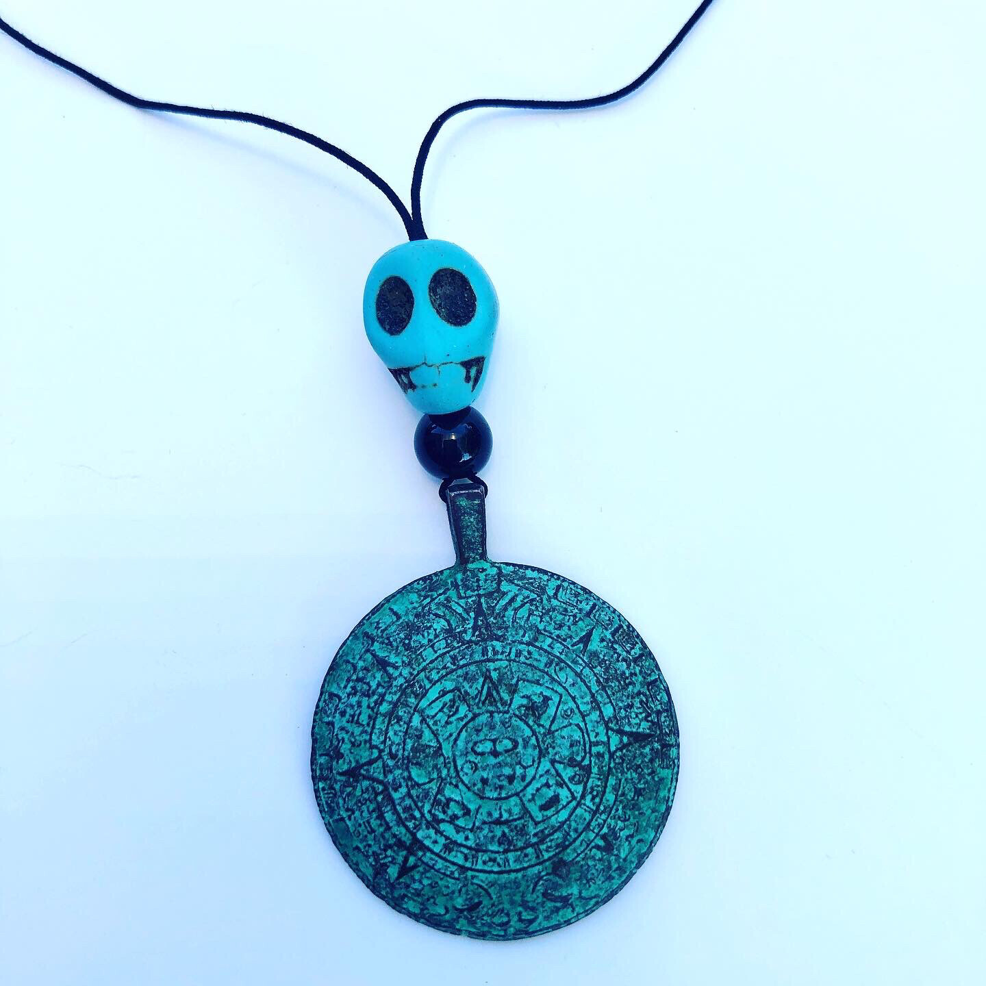 Aztec Calendar with Turquoise Skull Necklace