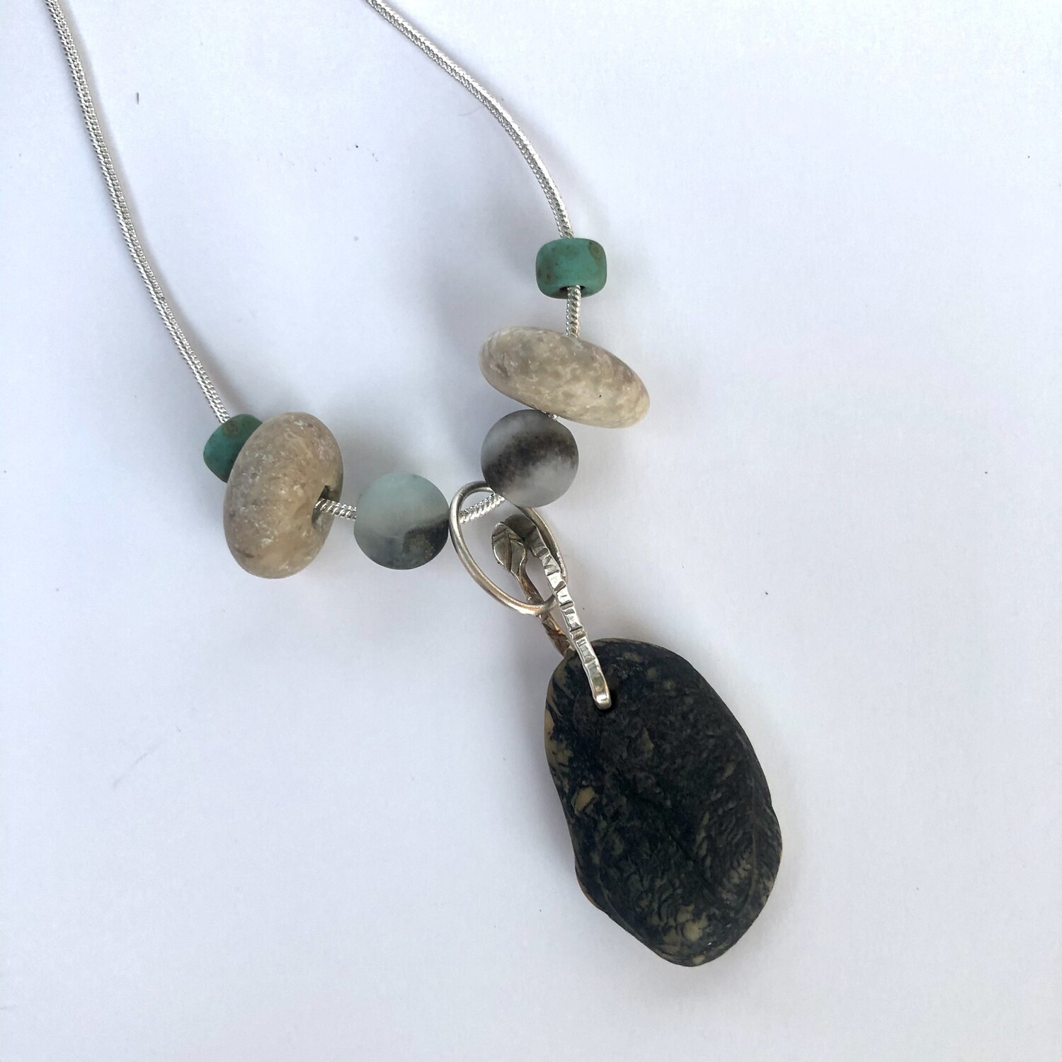 Sterling Silver Pendant with sea glass and fossilized stone