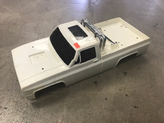 Clod body with roll bar and tailgate. Used, fair condition