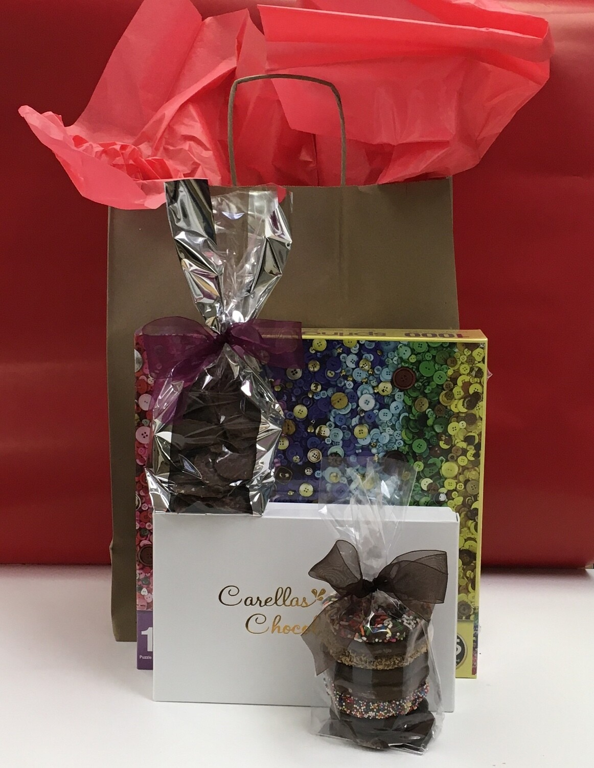 Drive up Package #1 - 1,000 piece puzzle, 2lb box of Assorted Chocolates, Choc Cov'd Potato Chips and 3 Ring Gourmet Pretzels.  Order and pick up at store or have it delivered! Puzzle design may vary.
