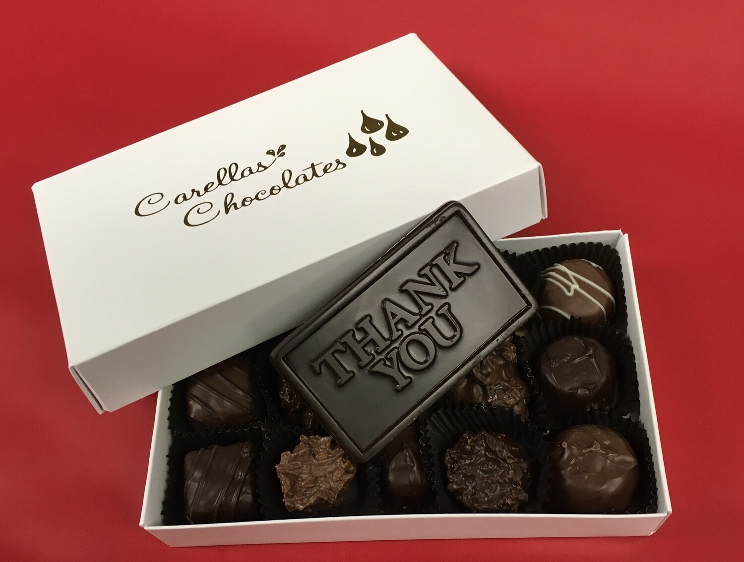 Add a Box of Chocolates with a Thank you Bar to your gift of a Plant.  Chocolates & Flowers!