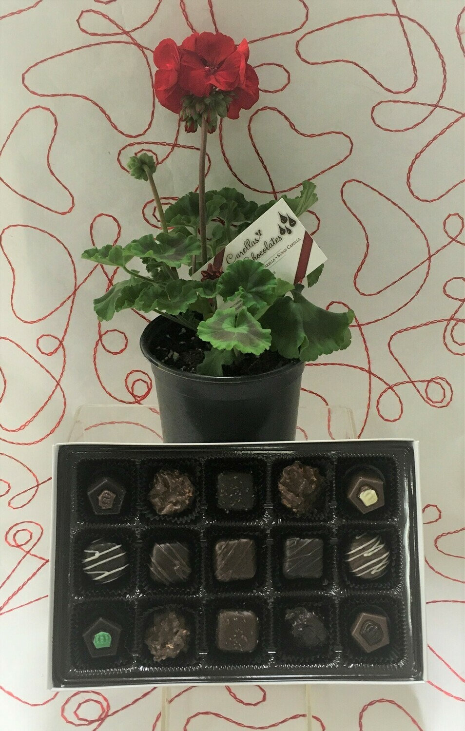 Send a Thank you to that Special Hero!  A 15 Piece Assortment of Milk and Dark Chocolate Favorites and a potted Geranium.