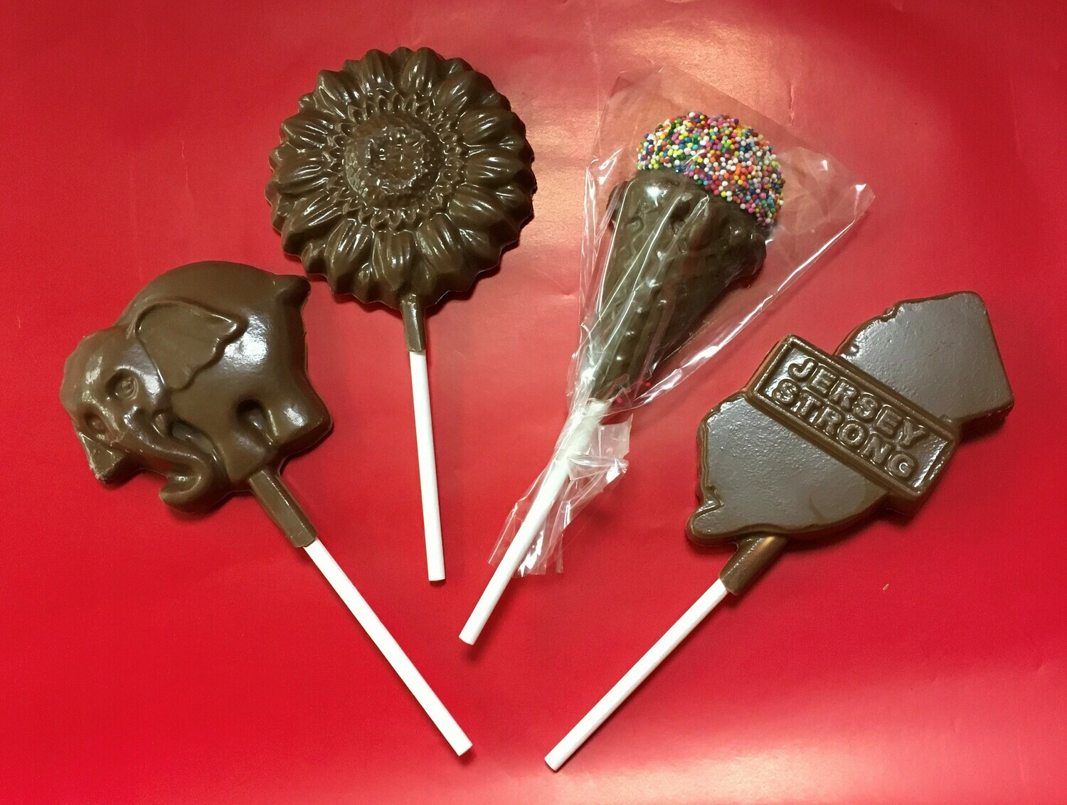 Chocolate Pops.  We only show a few here but we have pops for many occasions.  Give us a call and we will work with you to create your themed chocolate pop! Pops can be made in milk or dark.