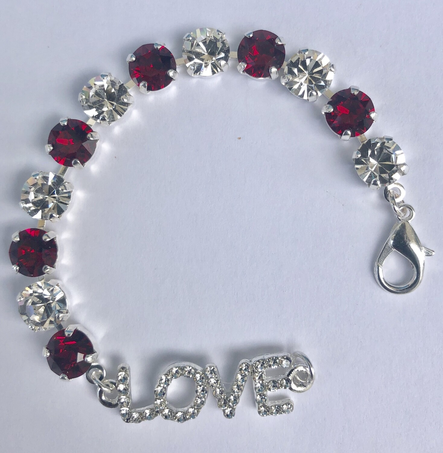 """""""Everlasting"""" Love Bracelet consists of ruby red and clear crystals with a silver finish.  Handmade by Raine"""