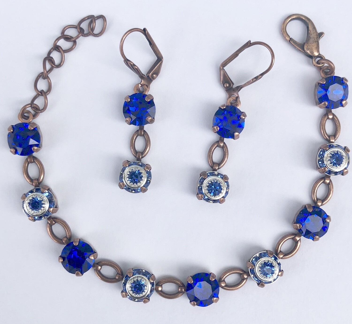 """""""Celestial"""" Saphire Blue Bracelet with a copper finish with matching lever back earrings.  Handmade by Raine."""