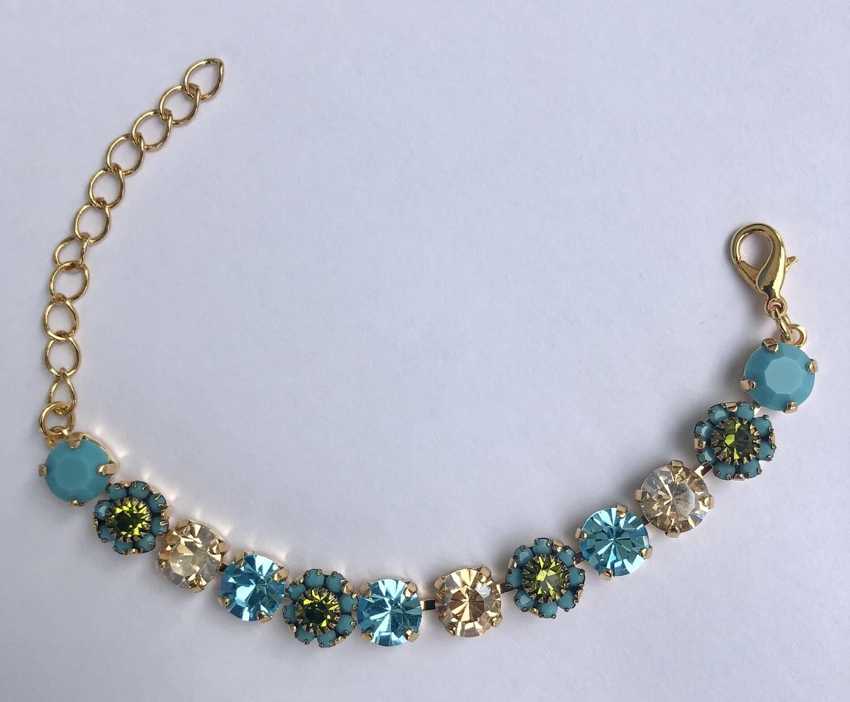 """""""Paradise) Turquoise amd Blue Bracelet with a Gold Finish."""