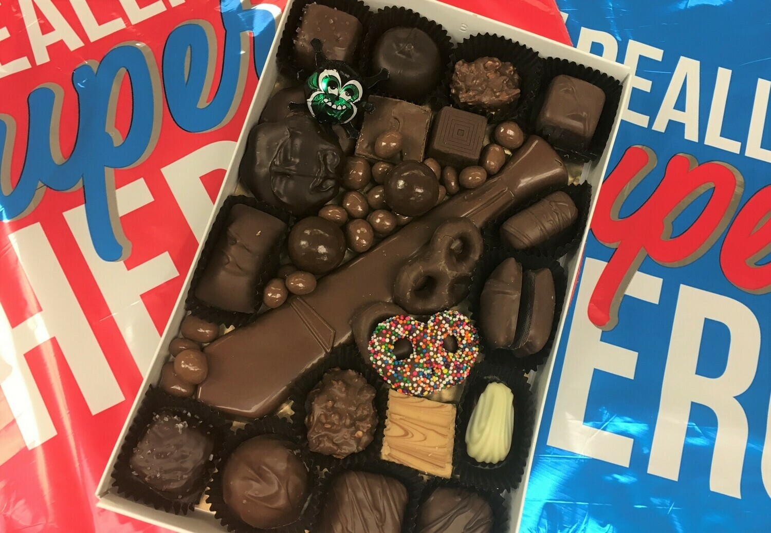 One Pound of Chocolates with Milk Chocolate tie.  Cheweys, Peanut Butter, Pretzels and more.  Give Dad a Treat and a Tie! Free masculine gift wrap.