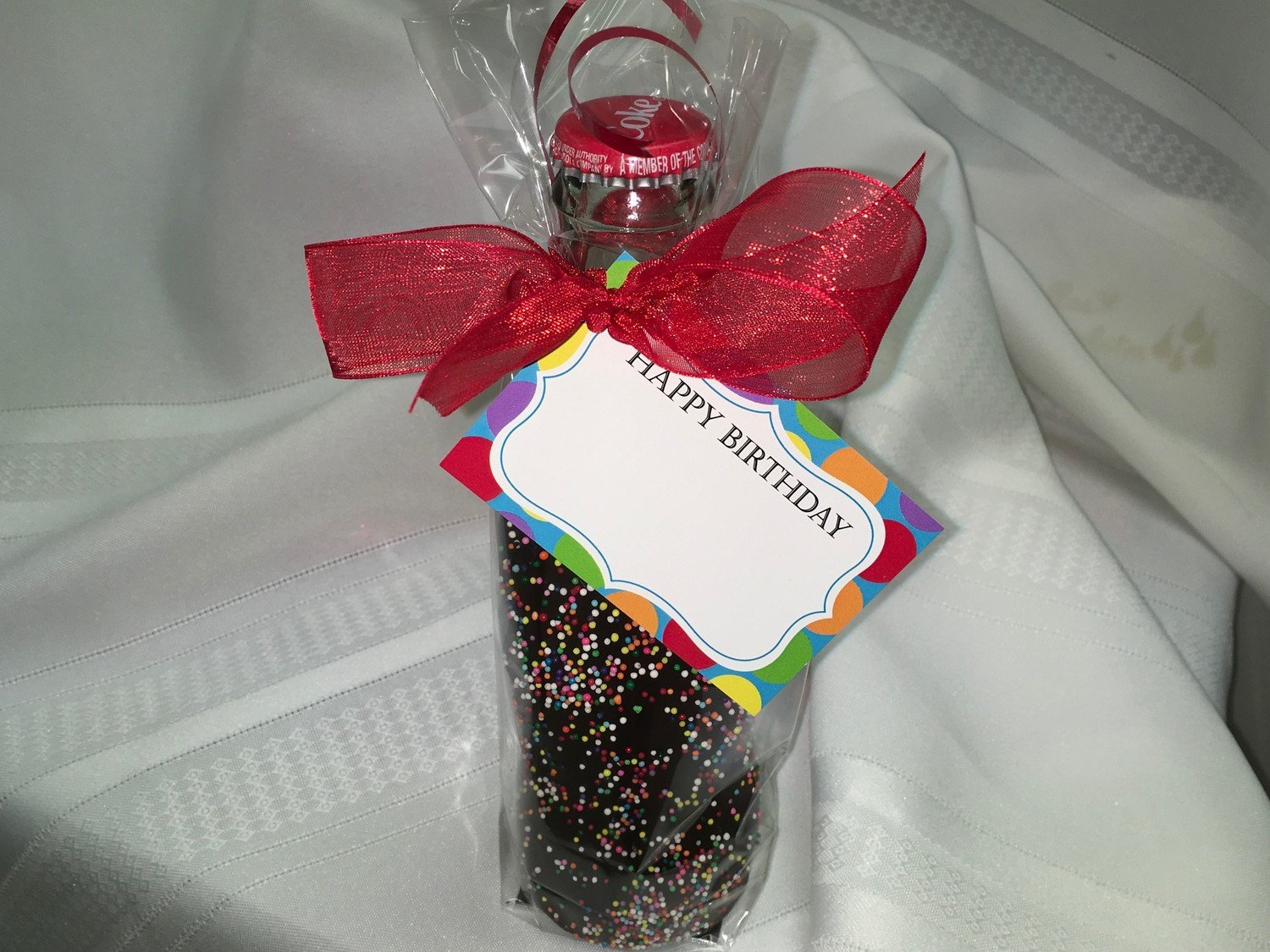 Chocolate Covered 8 ounce Beverage.  Easy Chocolate Removal.  Hand dipped in our Chocolate Kettle. Tag included.