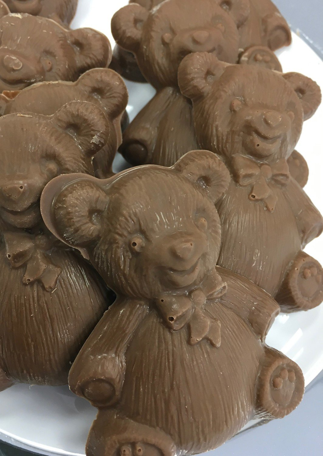 "Solid Chocolate Teddy Bears.  Milk Chocolate Only.  3"" x 2"" approx.  Peanut and Gluten Free.  20 to a Lb."