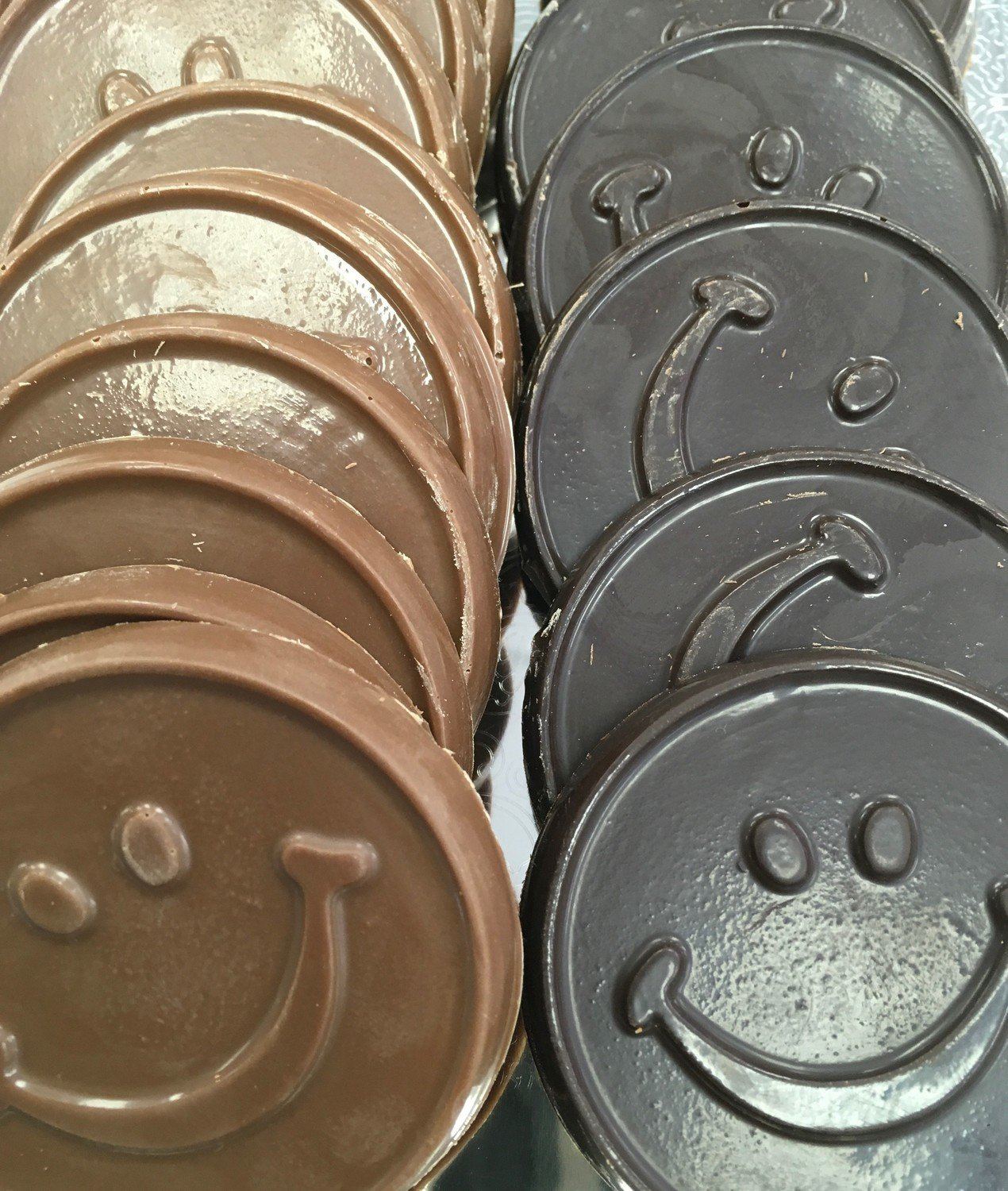"""F - Chocolate Smiley Faces. 2 1/4"""" approx.  Peanut and Gluten Free. 20 to a Lb."""