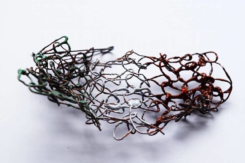 Copper knitted wire brooch.