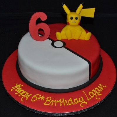 Pikachu on round Poke Ball inspired cake