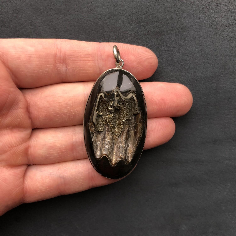 Pendant with ammonite geode