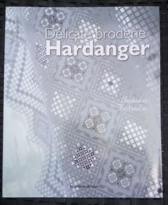 delicate broderie hardhanger