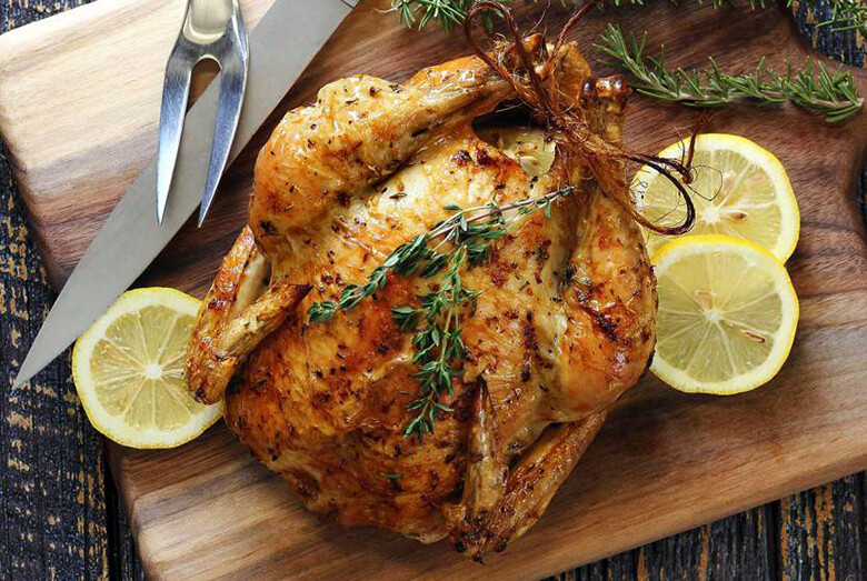 Whole stuffed Chicken with fruit, onions, and sage. (+/-2kg) raw