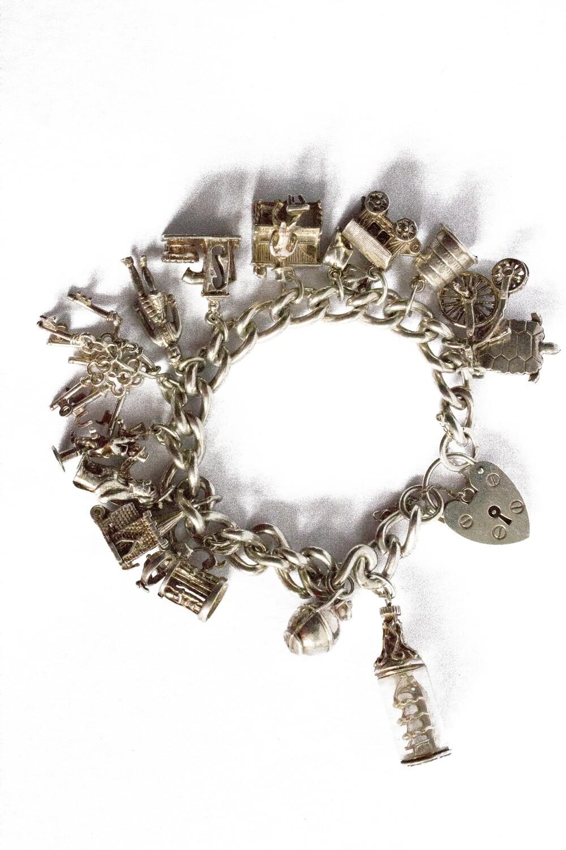 Circa 1970 Silver Full Charm Bracelet