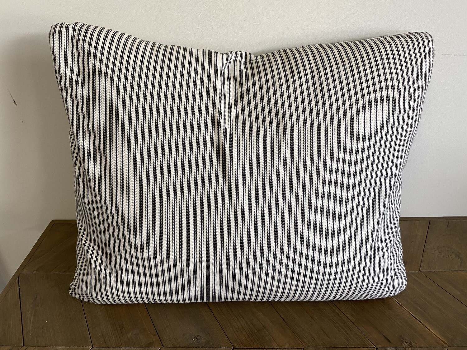 Scatter cushion in ticking