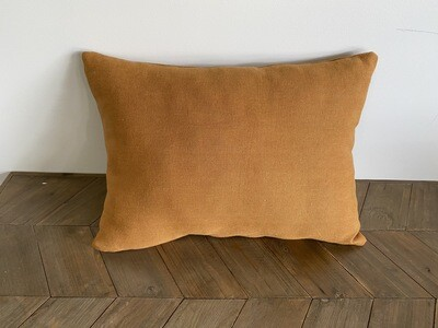 Rust coloured linen cushion