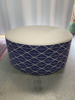 Large round ottoman with feather scatter cushion