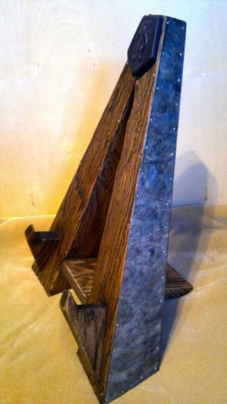 Rustic guitar stand with embossed leather pillow