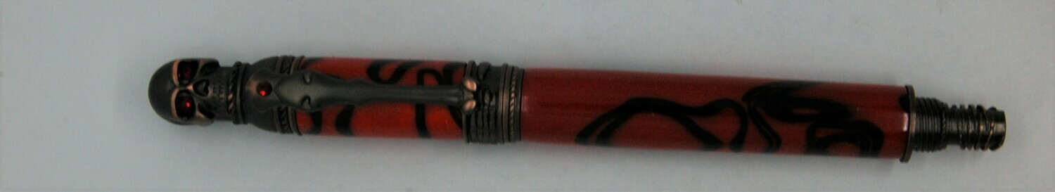 Bone-writer Fountain Pen  Red with black  swirls resin.  Hardware is Oiled rubbed bronze.