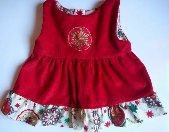 Pinafore with frill - red with x-mas print