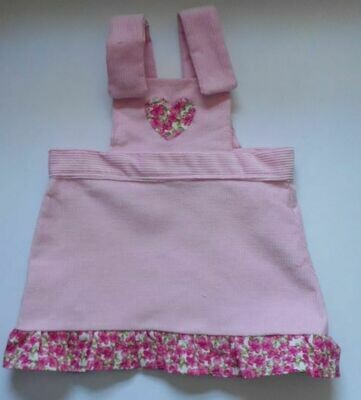 Pinafore with frill for dolls - pale pink