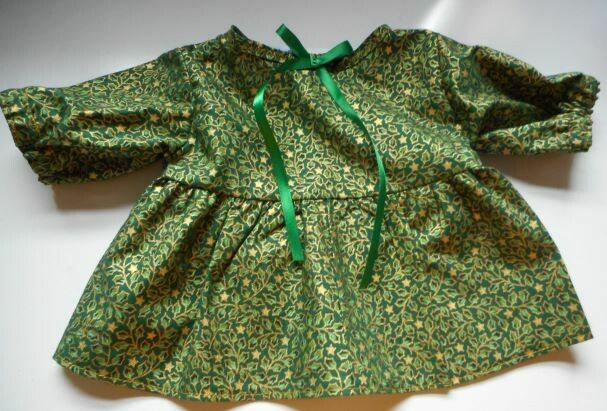 Dress in a gold and green holly print-bear