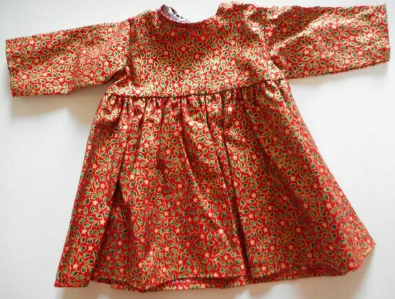 Dress for dolls in red, green and gold holly and star print.