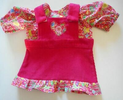 Outfit: Pinafore with frill and top in bright pink
