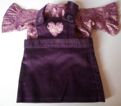 Outfit: aubergine corduroy pinafore with frill sleeved top