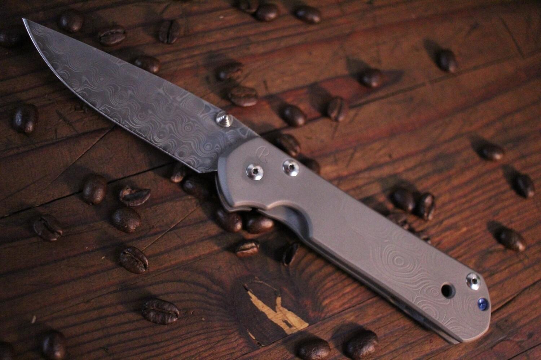 "Chris Reeve Large Sebenza 21 3.625"" Folding Knife, Titanium Raindrop Graphic / Raindrop Damascus ( Pre Owned )"