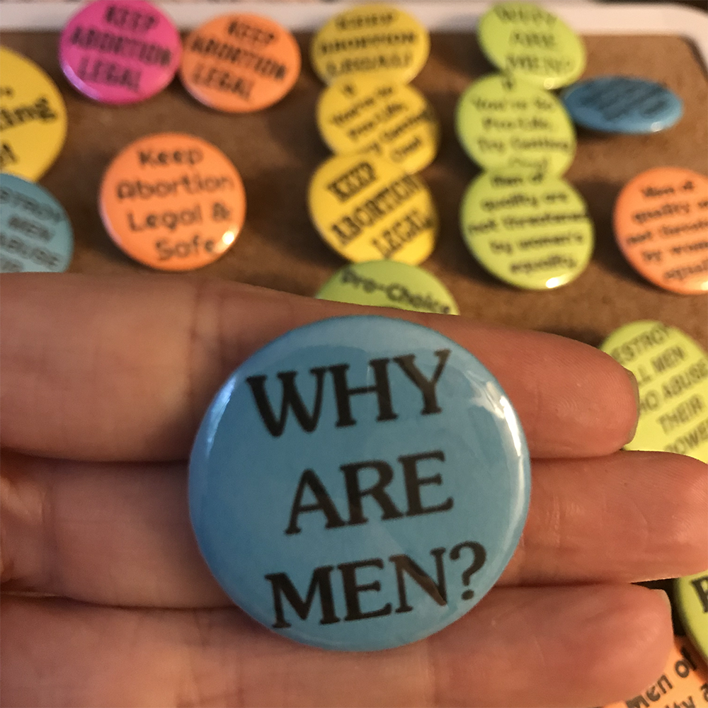 WHY ARE MEN? Button