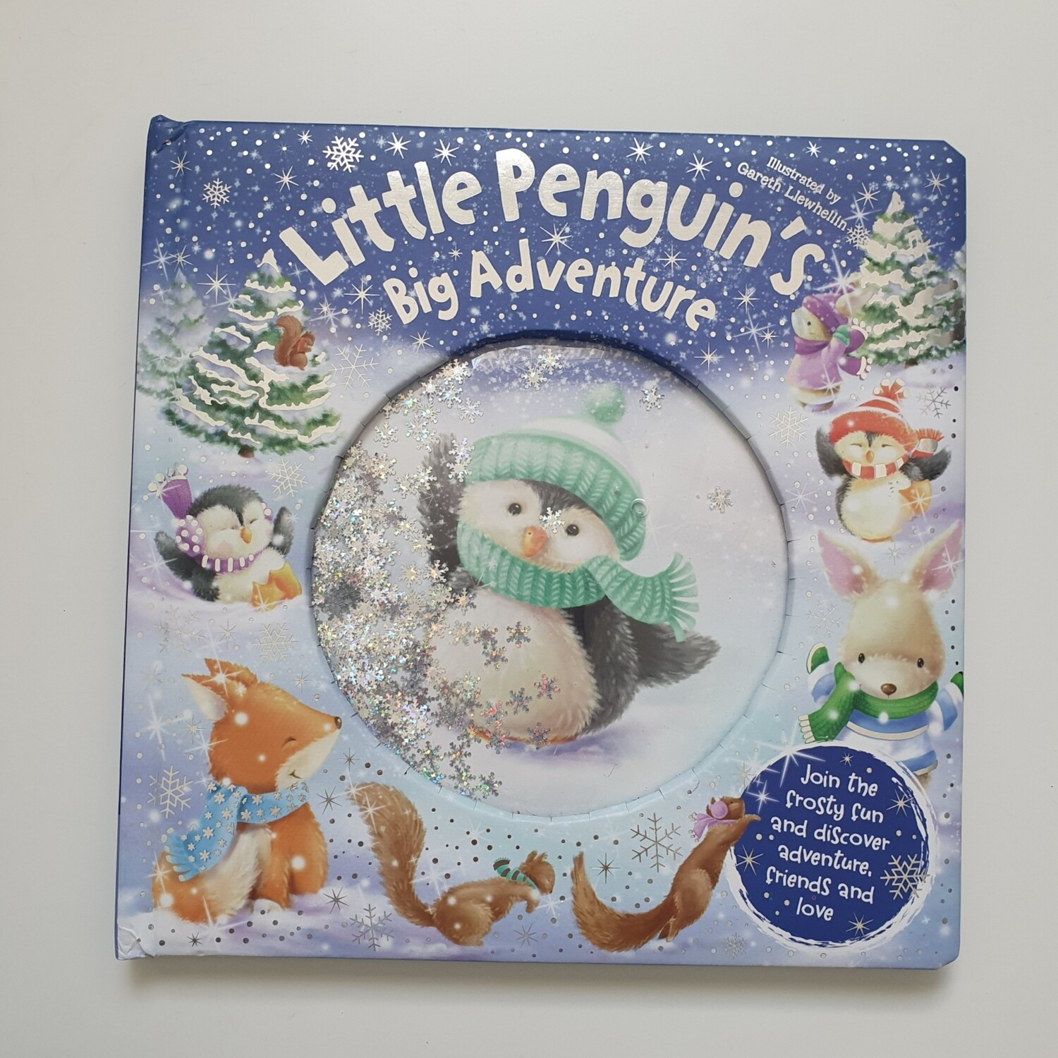 Little Penguin's Big Adventure - water snowflakes on the cover