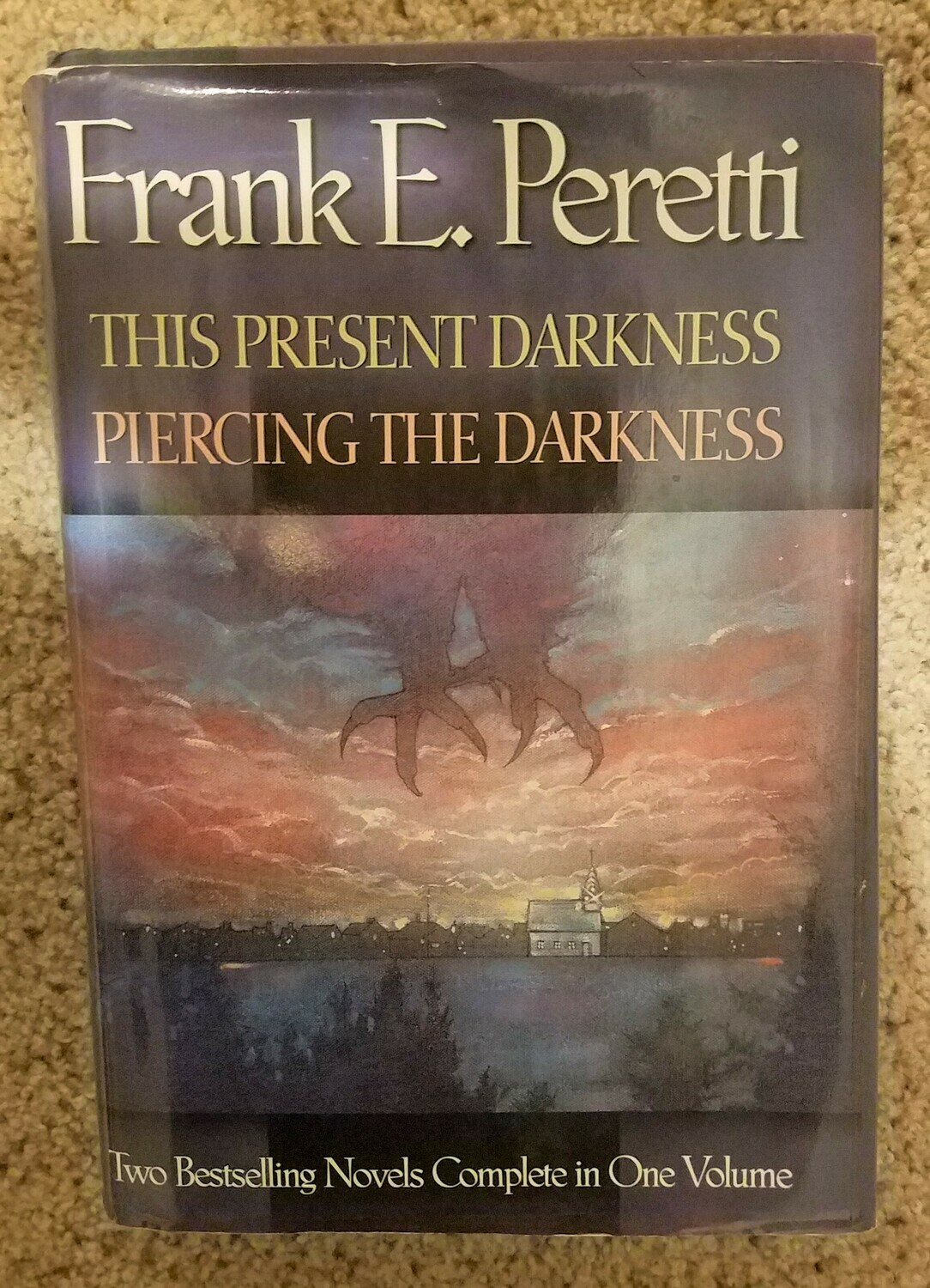 This Present Darkness and Piercing the Darkness by Frank E. Peretti