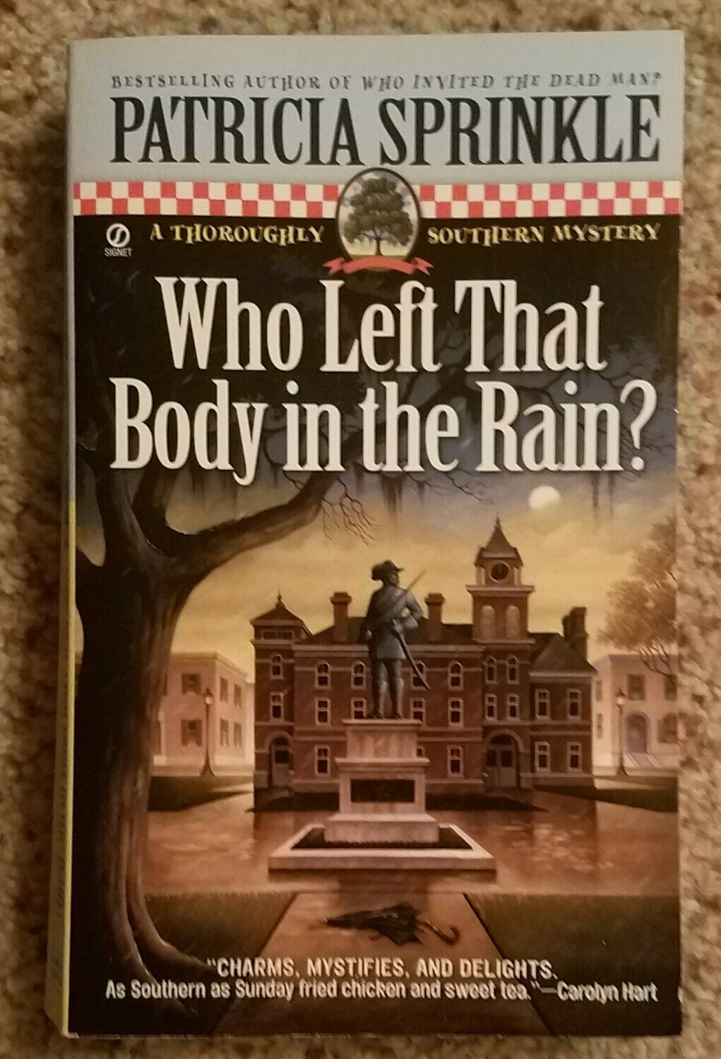 Who Left That Body in the Rain? by Patricia Sprinkle