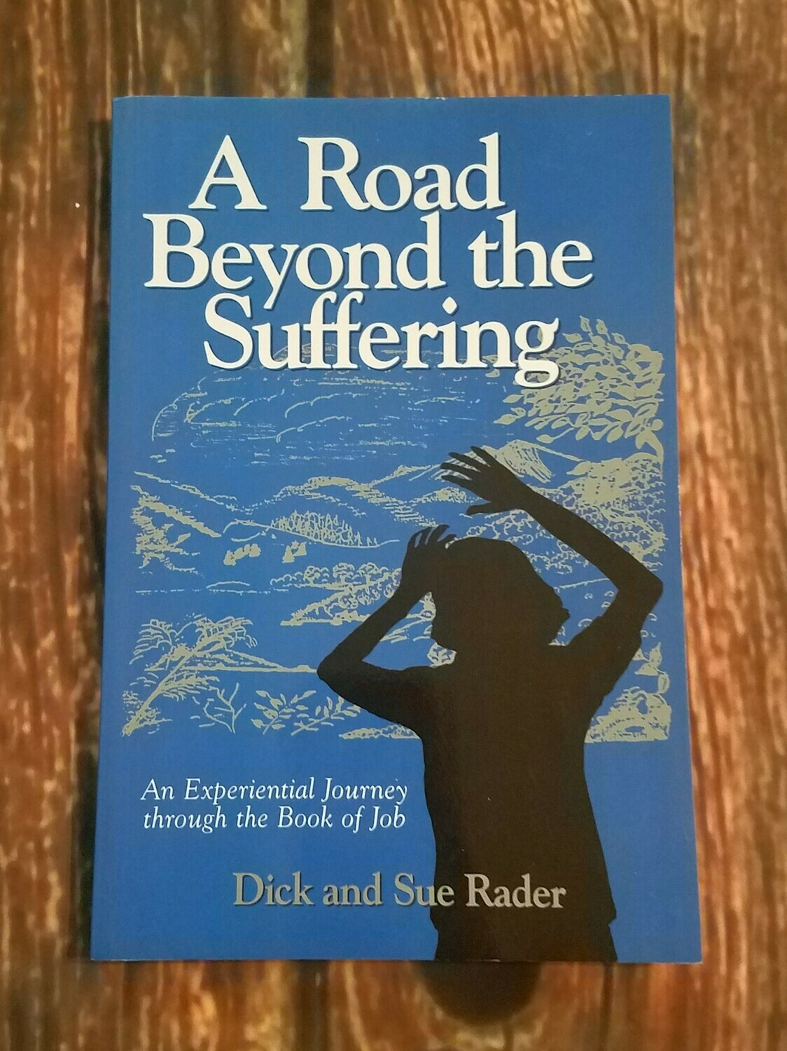 A Road Beyond the Suffering by Dick and Sue Rader
