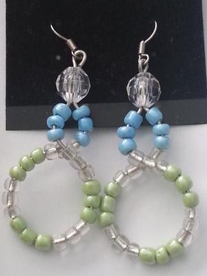 Figure eight earrings/ Boucle d'oreille retour en huit