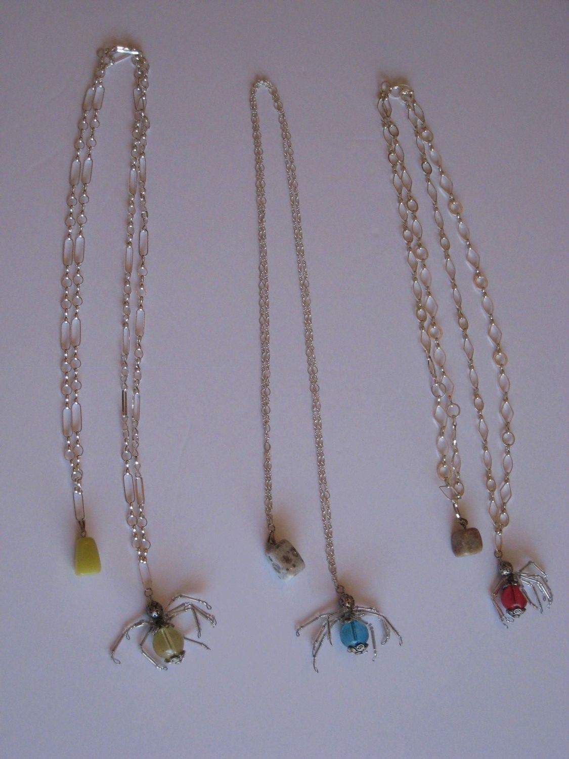 3 SPINNER NECKLACES/ 3 ARAIGNEE COLLIERS