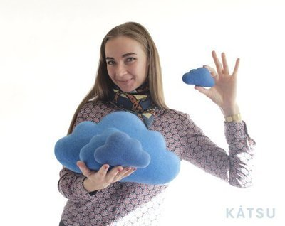 Blue woollen cloud cushion for children's room.
