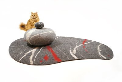A felted stone-carpet made of natural wool. Item