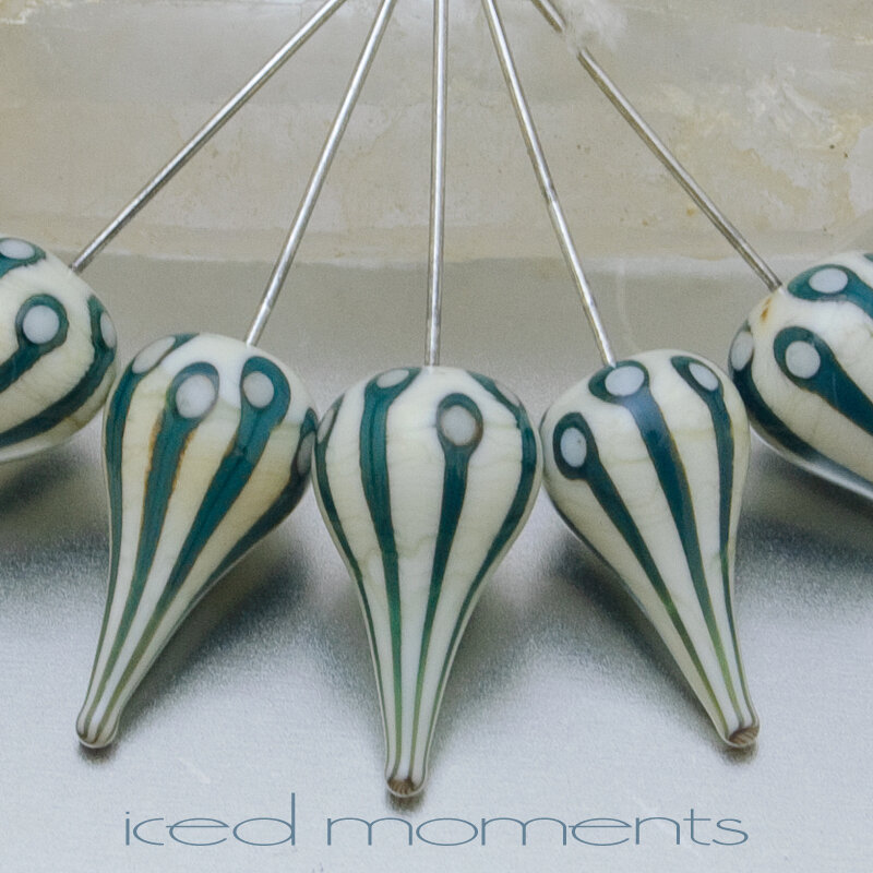 Walking Dot teardrops in ivory and green