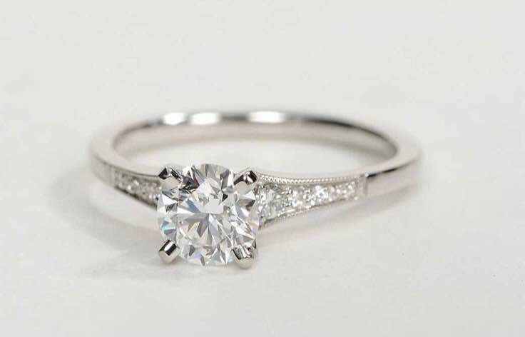 Four Prong Silver Solitaire Ring