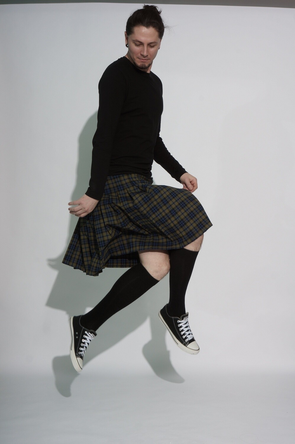 Sewing a kilt to order from fabric or genuine leather.
