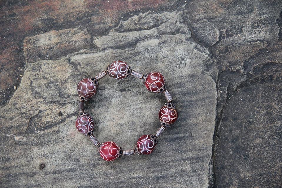 Red Swirly Ball Bracelet