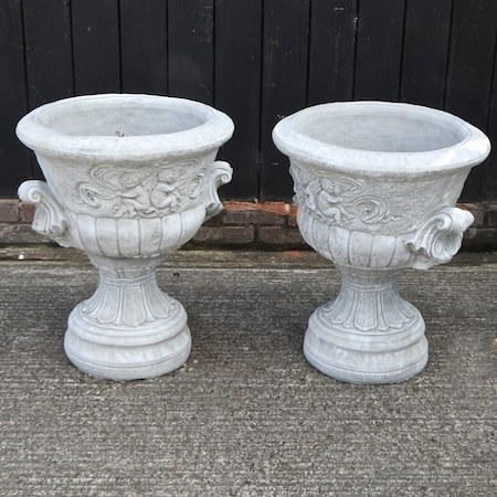 Lot 3,   A pair of reconstituted stone garden urns, 70cm high 80/120